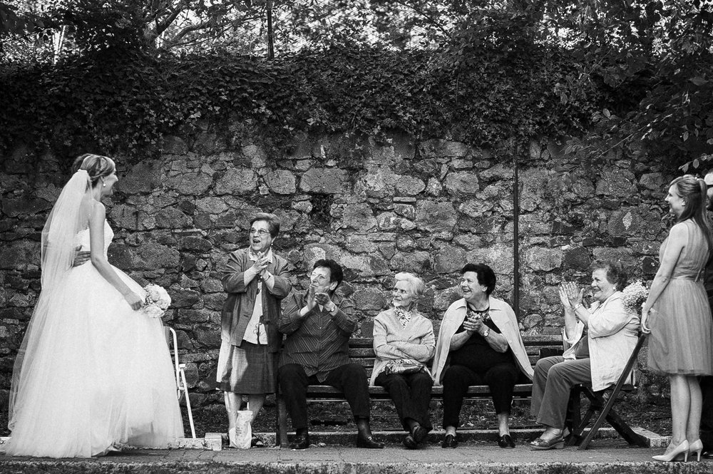 bride-and-groom-meet-old-ladies-wedding-in-italy-local-people-black-and-white-wedding-photography.jpg