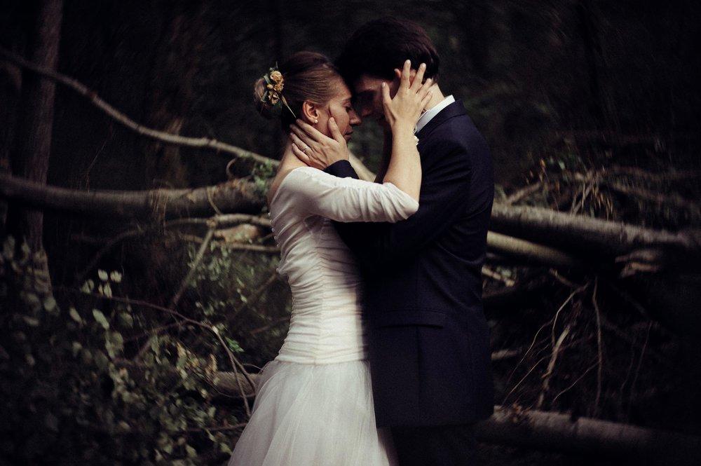 romantic-orange-teal-bride-and-groom-portrait-in-the-woods-looks-like-film.jpg