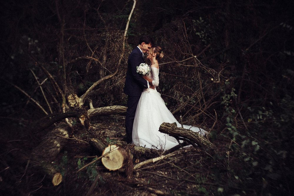 wedding-couple-in-the-woods-smiling.jpg