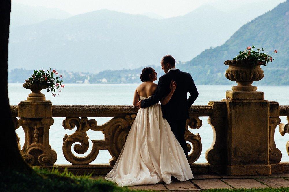 bride-and-groom-looking-balcony-Villa-Del-Balbianello-Bellagio-Lake-Como-Wedding-Photographer-Italy-Alessandro-Avenali.jpg
