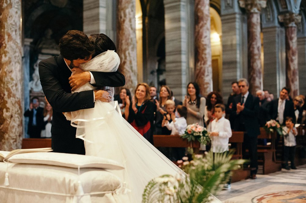 groom-hugs-the-bride-in-great-emotion-during-ceremony-wedding-in-rome-italy.jpg