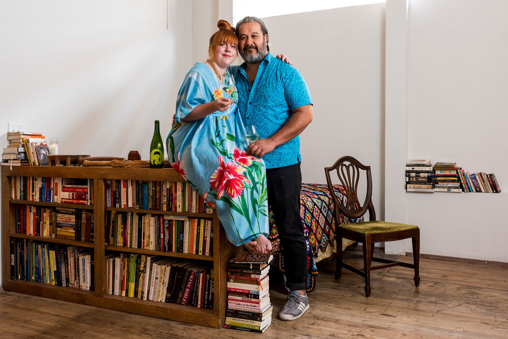 Caitlin Corcoran and Howard Hanna (and their bookshelf!)  Photo by  Dan Videtich