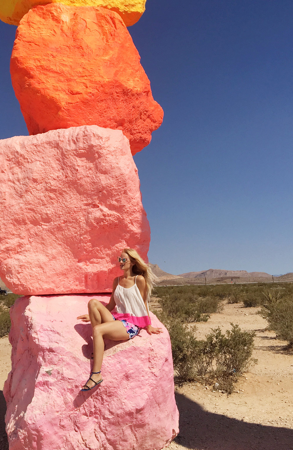 Sitting on one of Seven Magic Mountains | jumpseatjenny