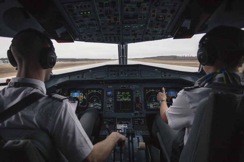 picture of pilots driving airplane.jpeg