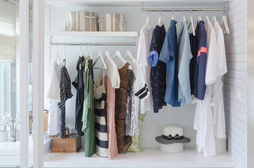 bigstock-Clothes-Hanging-In-Closet-With-111213401.jpg