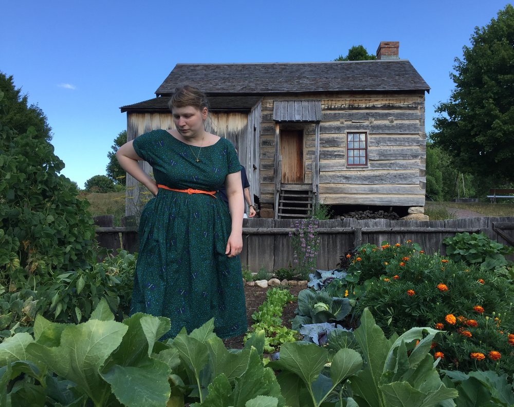 lizzy house in a garden in front of a historic farmhouse.JPG