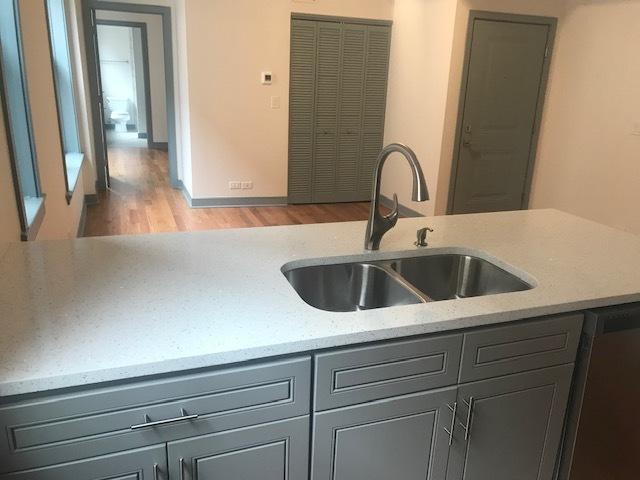 115 Oak Pk Rear Kitchen_Liv Rm.jpg