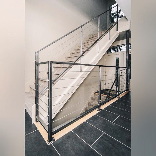A modern staircase for a modern home. Check out our projects at nwfinishing.com.