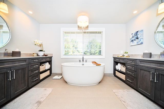 A duel mirrored vanity set creates an excellent balance in a 'his' and 'hers' bathroom.