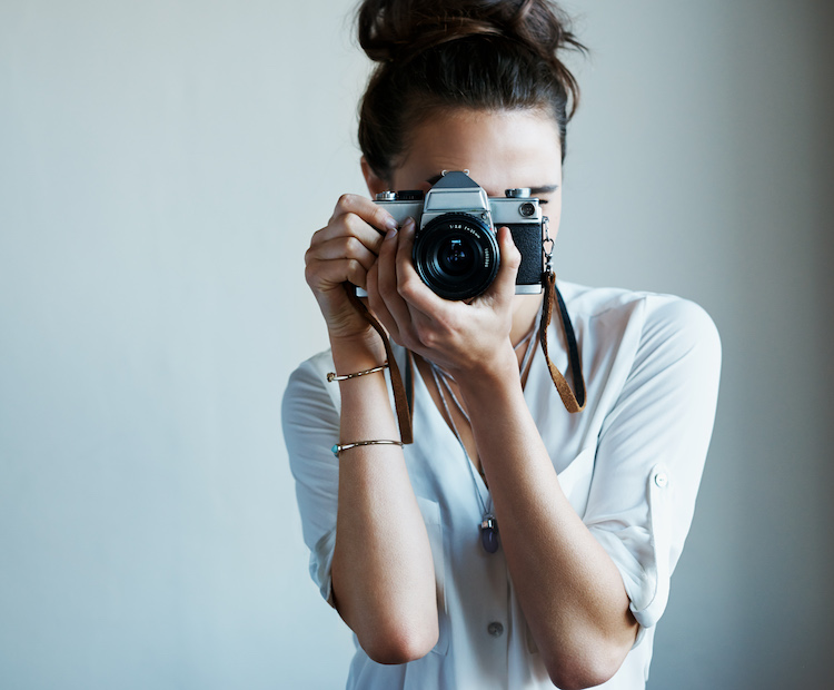main-woman-holding-camera.jpg