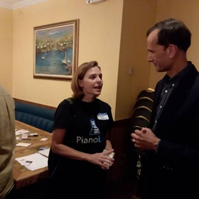 Marilyn O'Leary of Piano Lab with Mount Vernon Supervisor Dan Storck