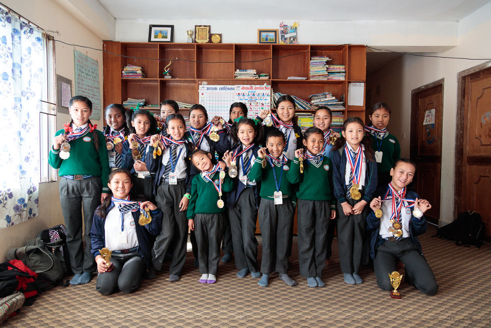 The girls at Himalayan Hope Home proudly present their athletics medals
