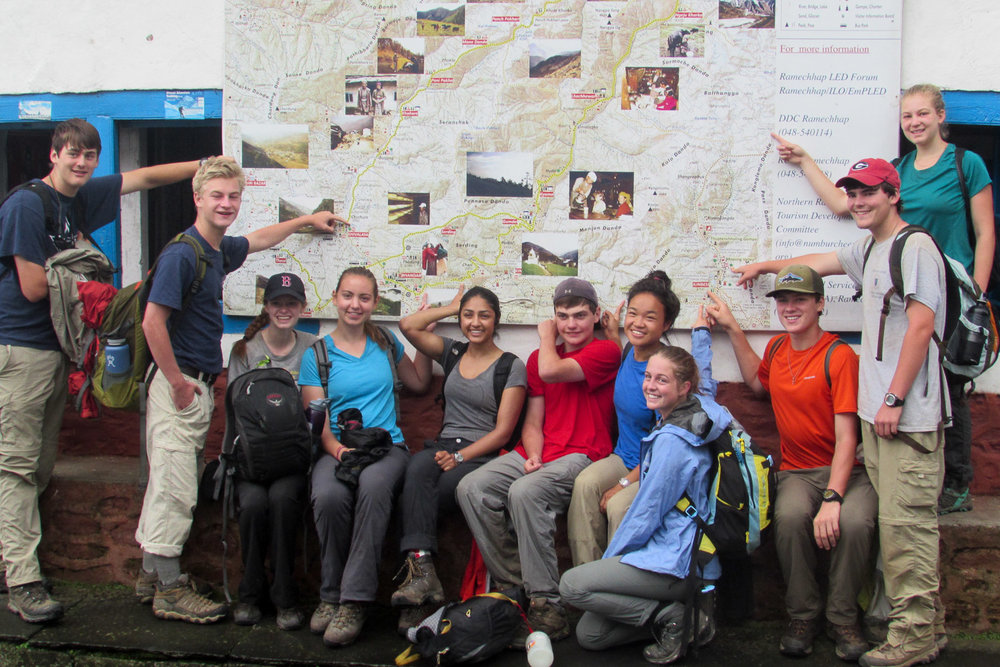During the Trek on the classic Everest trail, students point out where they have been on the map.