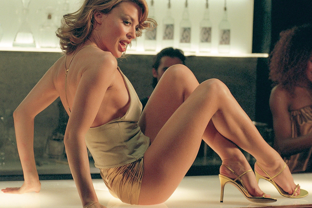 Kylie Minogue wearing gold hotpants in the  Spinning Around  music video (2000).