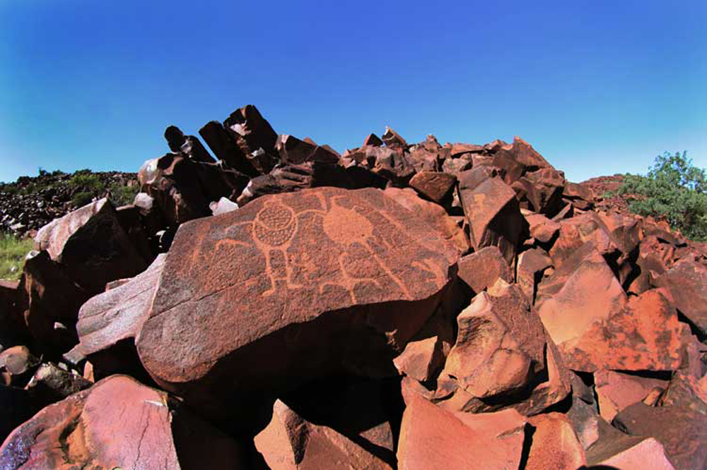 A Burrup petroglyph in the context of the landscape / Photograph courtesy of FARA