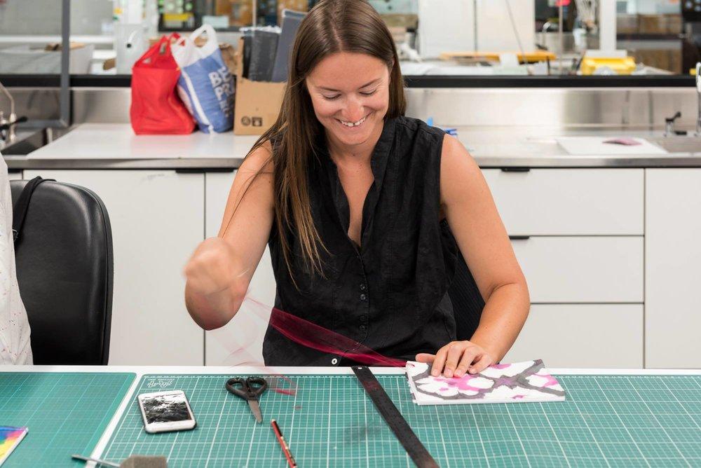 Rare Trades organiser Grace Barrand stitches her handmade book