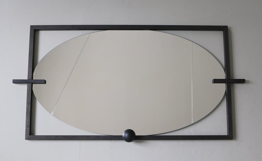 - LARGE WALL 'EYE' MIRROREXPERIMENTAL COLLECTIONoval deep engraved mirror, polished edge, set in matt black hand-carved oak, graphic elements of oak and beechdimensions: 135 x 67 , th 5 cm750 EUR
