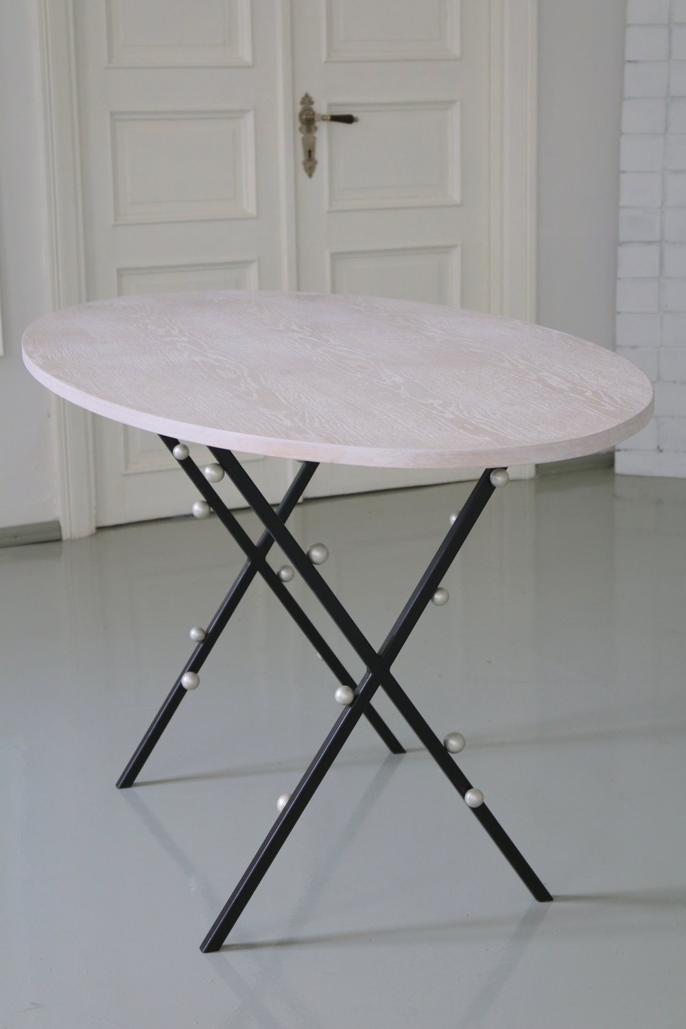 - XX PEARL TABLEEXPERIMENTAL COLLECTIONcross steel legs with hand-painted cream pearlsoval, cream white oak topdimensions: 170 x 80 cm, h 75 cmEUR 500 (price for a prototype item)