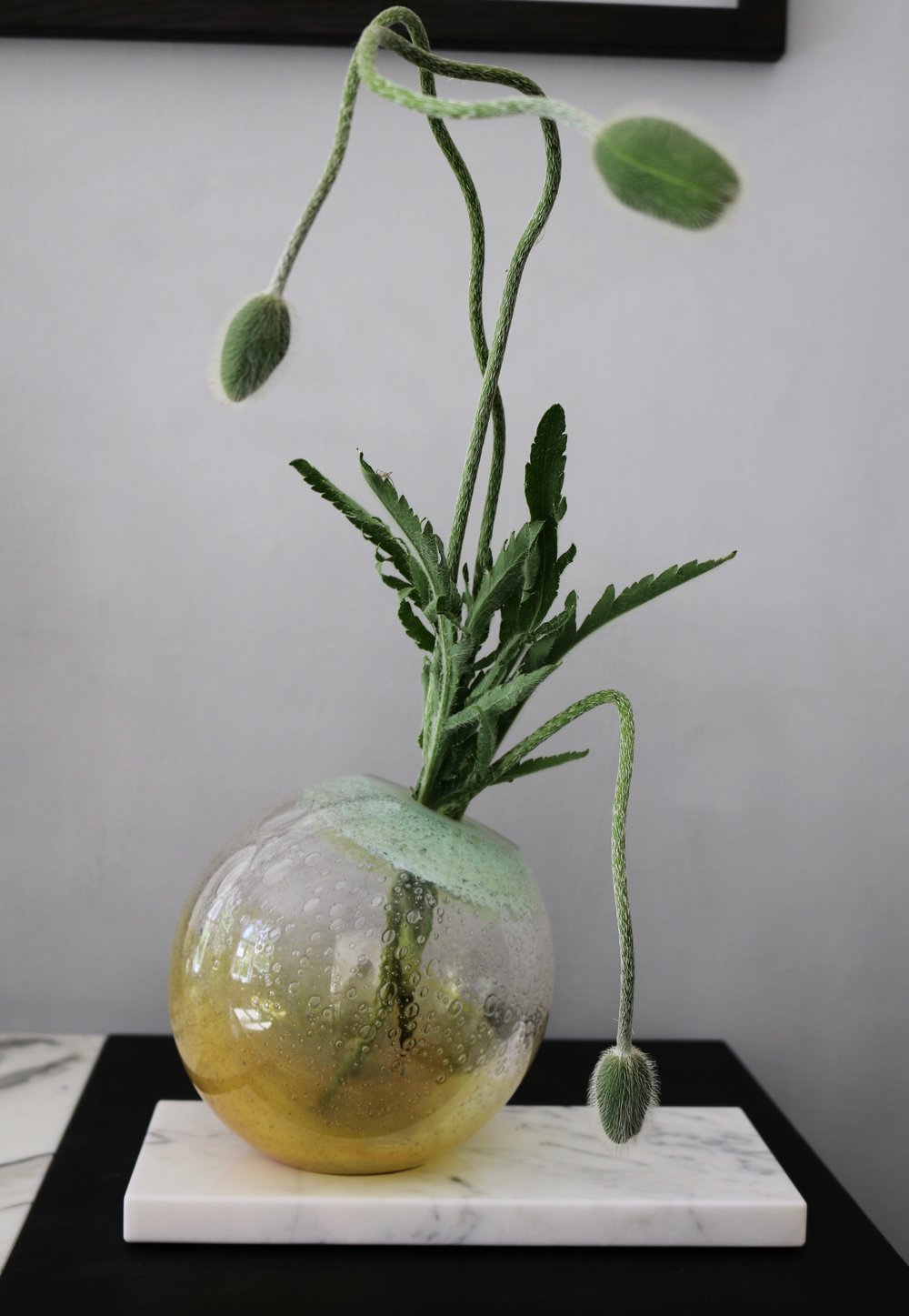 - EXQUISITE GLASS UNIVERSEEXPERIMENTAL x baibaglass (baiba dzenīte)Mouth-blown glass vase in warm yellow, mint green and clear. Extra clear glass.On hand-cut polished Carrara marble base.'Elegant but fun, suitable for a gift or would fit anywhere to soothe ever-beauty-seeking eye'dimensions : 27 x 15, H 17.5 cm420 EUR