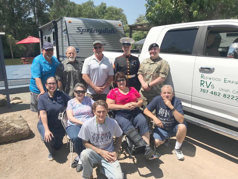 Top row, from left to right, are Tony Barthel, RV geek, Redwood Empire RVs; Ron Quick, Operation Tango Mike; Perry Bates, owner, Redwood Empire RVs; Staff Sgt. Joshua A McCorkle, USMC; Staff Sgt. Cameron R. Bornowski, US Army; center row, left to right, Lisa Wilson, Clear Lake Campground; Marian Wilson, Clear Lake Campground; Ginny Craven, founder, Operation Tango Mike; Andrew Krones, Clear Lake Campground; and front row, Christopher Wilson, Clear Lake Campground