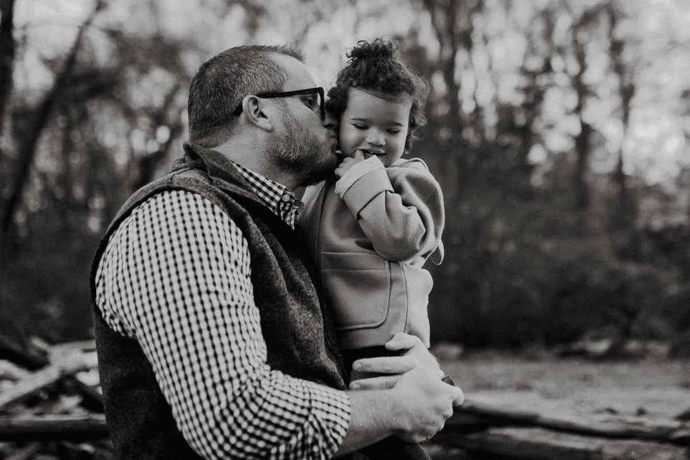 Black and white; portrait of a dad holding his toddler  at Ellanor C. Lawrence Park in Chantilly, Virginia