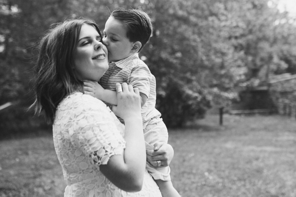 Black and white mother and son at Aldie Mill Lifestyle Family Photography