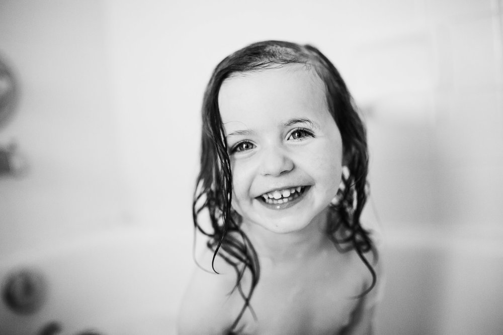 black and white portrait toddler girl grinning