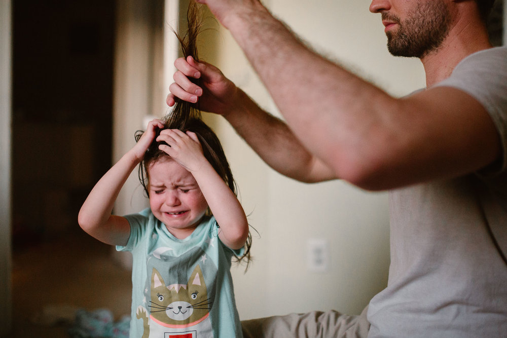 lifestyle childhood family photography ashburn virginia father brushing daughter's hair crying