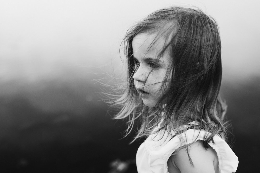 black and white portrait of a girl in a white shirt, hair blowing in the wind northern virgini lifestyle family photography