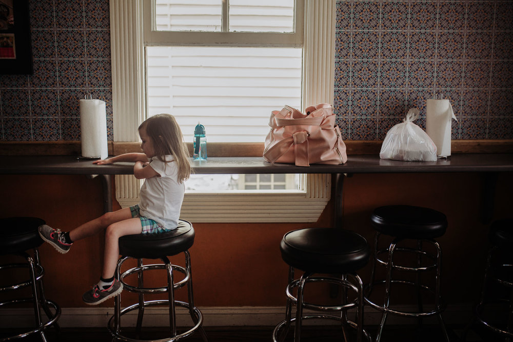 Girl sits on a bar stool at Senor Ramon's in Leesburg, Virginia