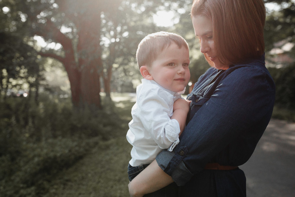mom holding her son close to her at Cabell's Mill in Chantilly, Virginia