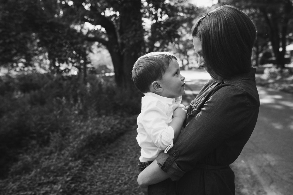 black and white; mom holding her son close to her at Cabell's Mill in Chantilly, Virginia