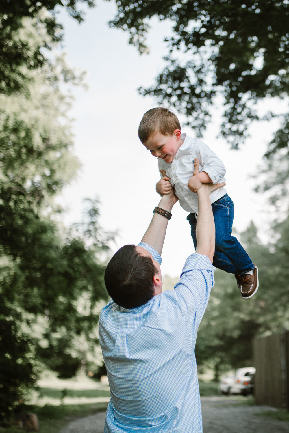 Dad lifts his son high above his head at Cabell's Mill in Chantilly, Virginia