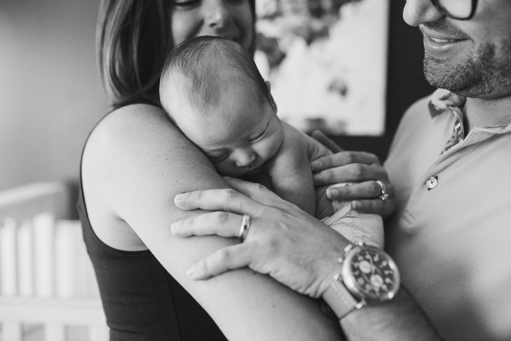Black and white; newborn baby boy family portrait with parents  in Ashburn, Virginia
