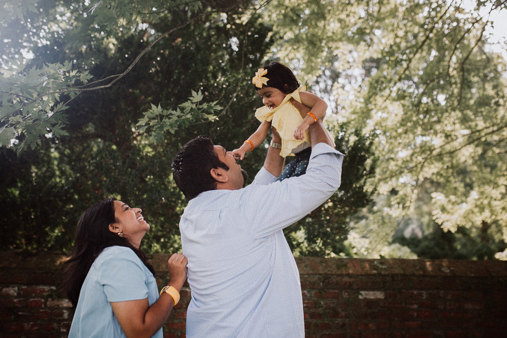 Family of three toddler mother father daughter golden hour sunset lifestyle Morven Park Leesburg Loudoun County Virginia Marti Austin Photography