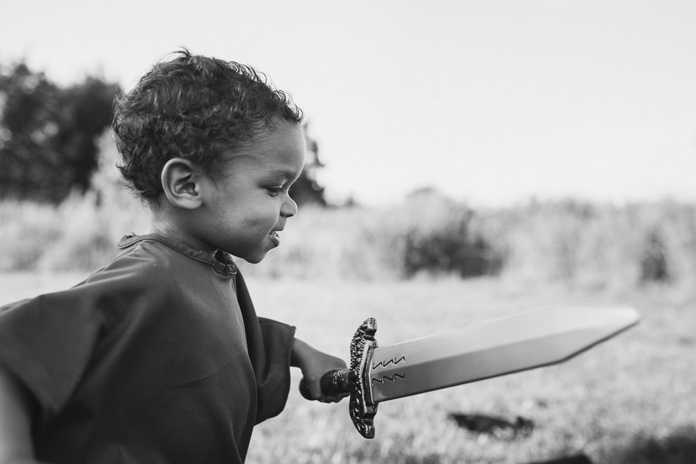 Black and white toddler boy lifestyle photography warrior fighter sword Beaverdam Run Ashburn Virginia Loudoun County Marti Austin Photography TGHP The Gold Hope Project