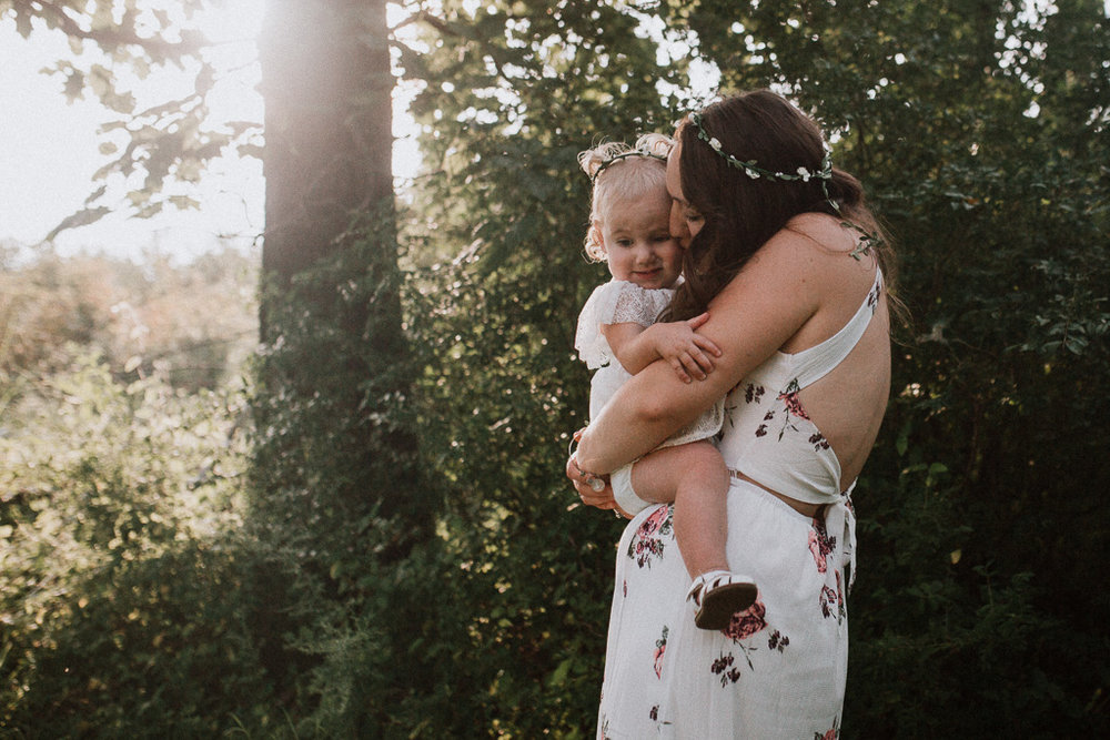 mother daughter golden sunset hug kiss family lifestyle photography Marti Austin Photography Rust Nature Sanctuary Leesburg Loudoun Virginia