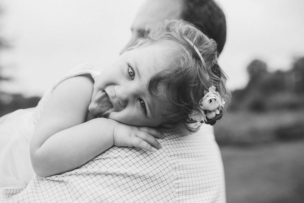 Black and white father daughter toddler girl sticking tongue out Sterling Virginia Claude Moore Park Lifestyle Family Marti Austin Photography