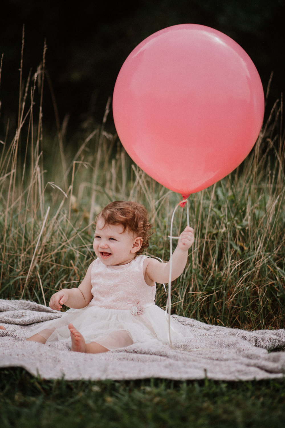 one year old girl toddler holding pink balloon Sterling Virginia Claude Moore Park Lifestyle Family Marti Austin Photography