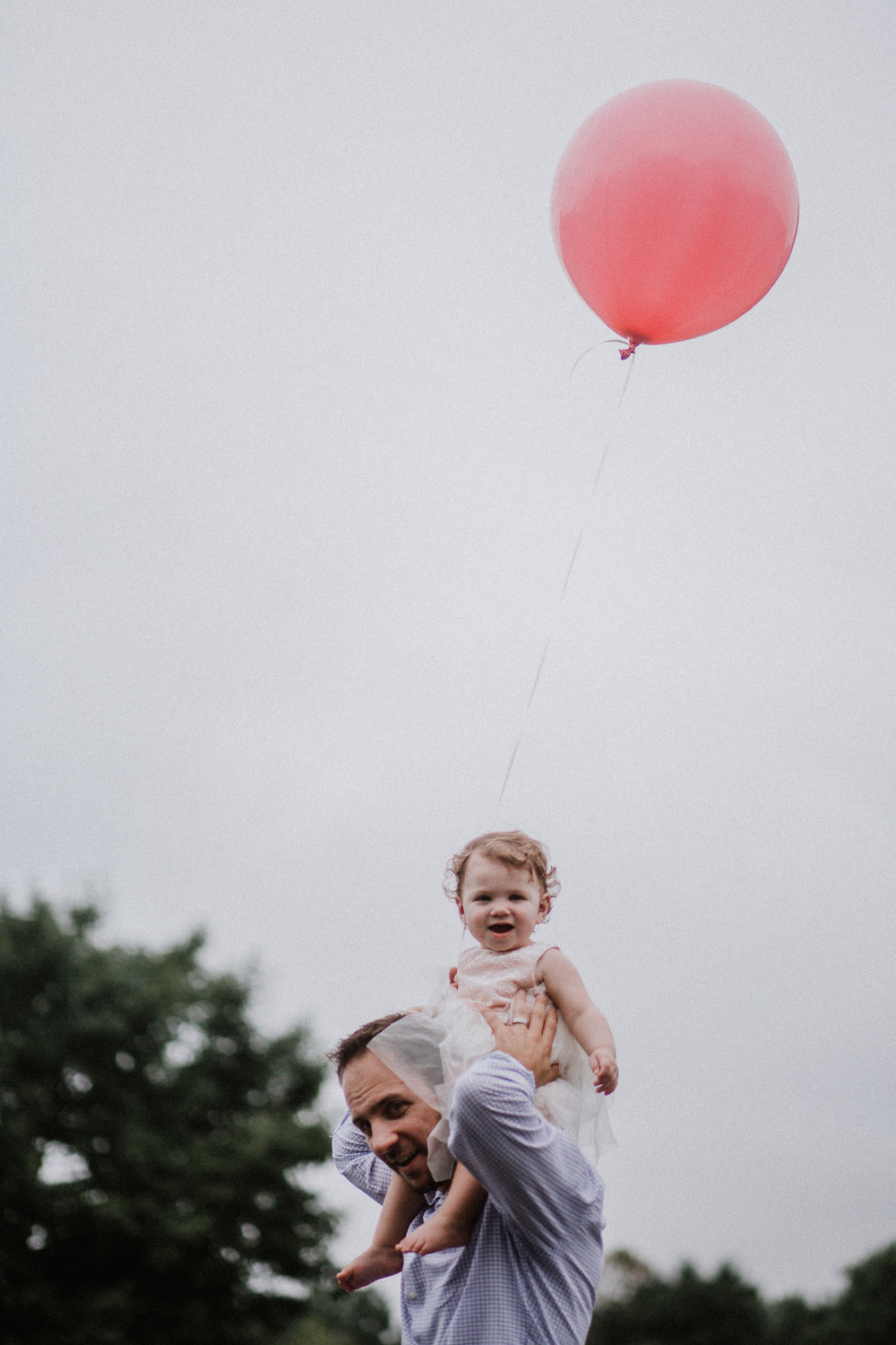 Toddler girl on dad's shoulders father daughter pink balloon birthday Sterling Virginia Claude Moore Park Lifestyle Family Marti Austin Photography