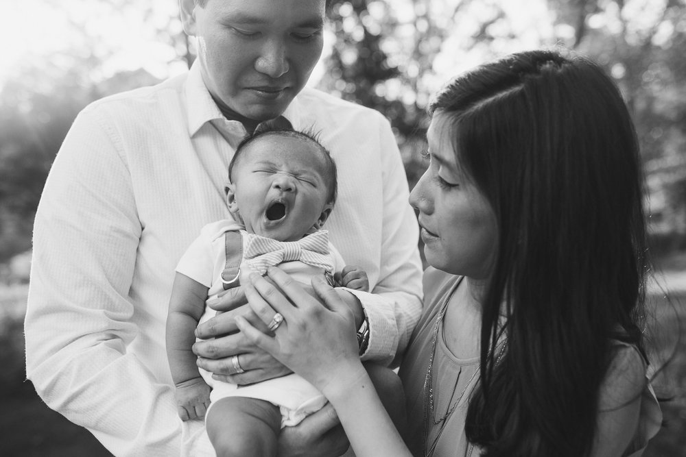 black and white family of three baby boy yawning sleepy mother father son Lifestyle family photography marti austin photography The Barn at One Loudoun Ashburn Virginia Loudoun County