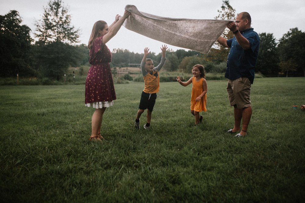 family of four blanket sunset Claude Moore Park Heritage Farm Museum Sterling Virginia Lifestyle Documentary Fall Family Marti Austin Photography