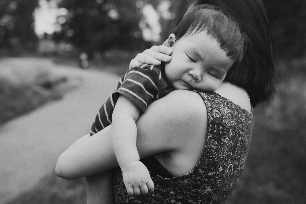 black and white baby boy asleep mom hug lifestyle documentary family Barn at One Loudoun Ashburn Virginia Marti Austin Photography
