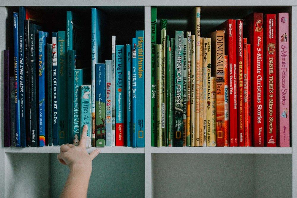 rainbow books reading hand Toddler Girl Ashburn Virginia Lifestyle Documentary Family Marti Austin Photography