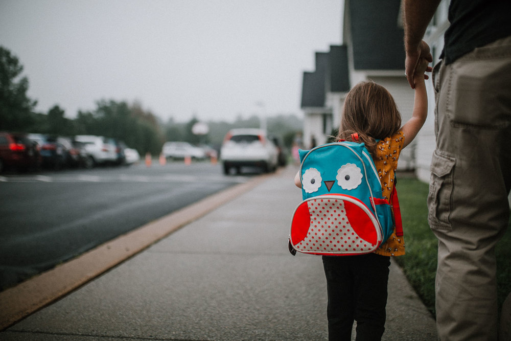 First day of school walk backpack holding hands Toddler Girl Ashburn Virginia Lifestyle Documentary Family Marti Austin Photography