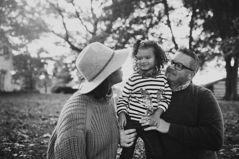 black and white mother father daughter family of three  fall autumn Wolf Trap Vienna Virginia Lifestyle Documentary Family Marti Austin Photography