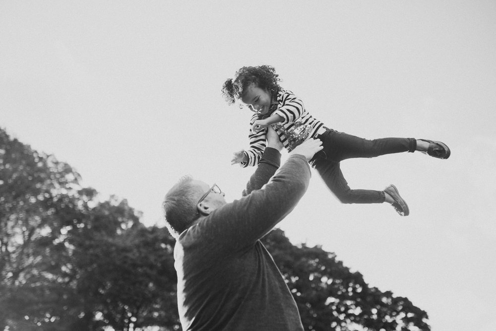 black and white father daughter lift throw fall autumn Wolf Trap Vienna Virginia Lifestyle Documentary Family Marti Austin Photography