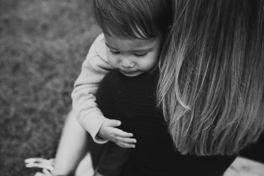 black and white mother son toddler hug fall autumn family lifestyle documentary Claude Moore Park Sterling Virginia Marti Austin Photography
