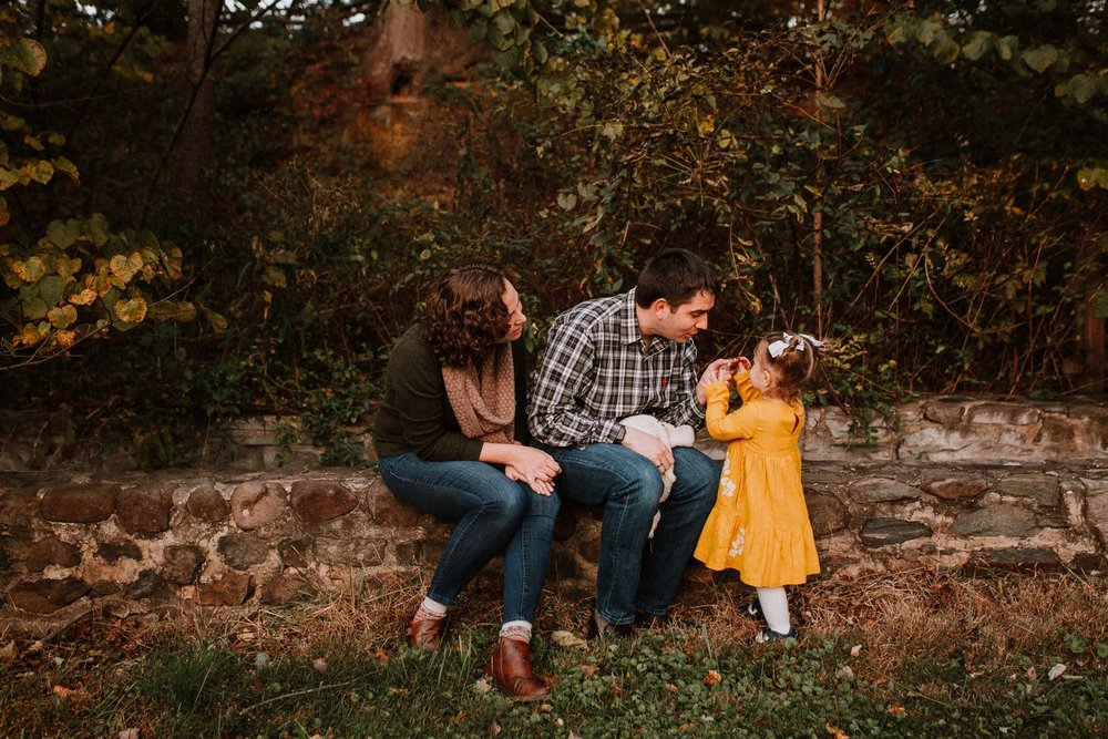 mother father daughter stone wall leaves fall sunset family lifestyle documentary Colvin Run Mill Great Falls Virginia Marti Austin Photography