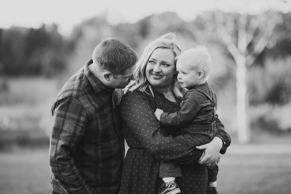 Black and white mother father son toddler fall autumn lifestyle documentary Heritage Farm Museum Sterling Loudoun Virginia Family Marti Austin Photography